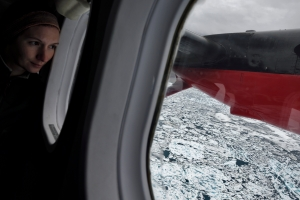 Gina Moseley looks out at the sea ice on the flight between Akureyri and Constable Point