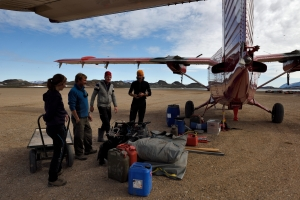 The team load the equipment onto the Twin Otter