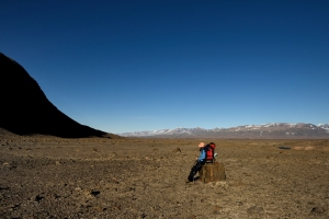 Gina Moseley rests on the walk back to base camp
