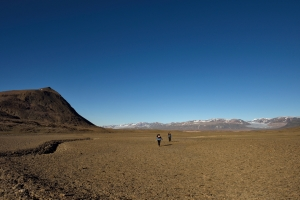 Gina Moseley and Christoph Spötl hike back to base camp